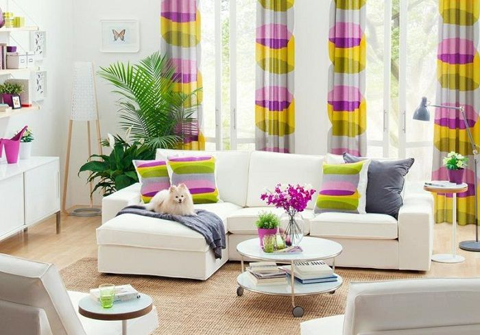 Multi-colored patterns are used as accent the tiny living room.