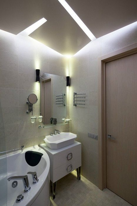 Beautiful bathroom interior is created through non-standard lighting that will enchant at first sight.