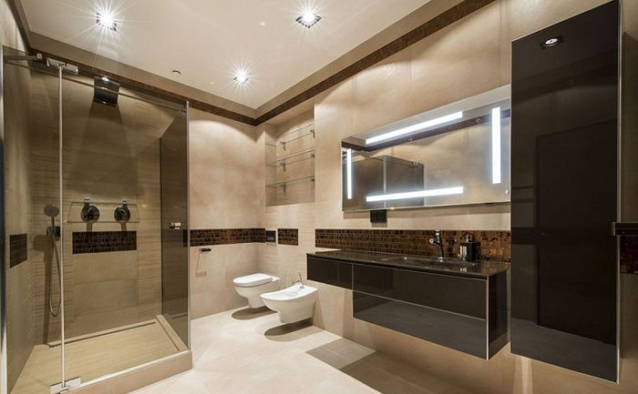 Excellent decision to issue a bathroom with a combination of dark and light tones.