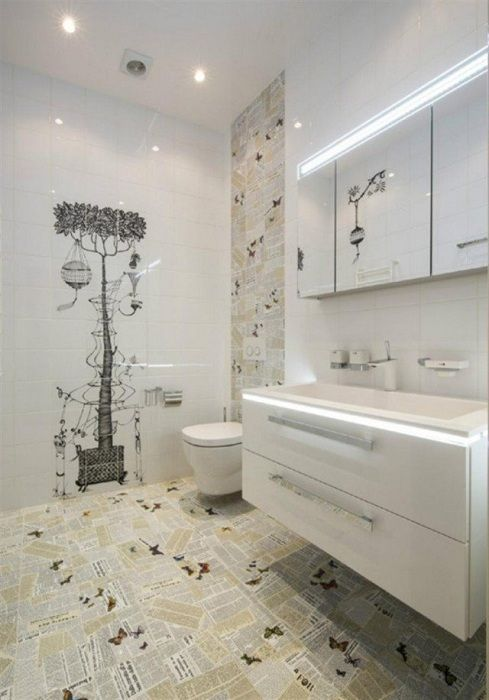 Cool design of a bathroom using tile decorated with newspaper print, which will create excellent interior.