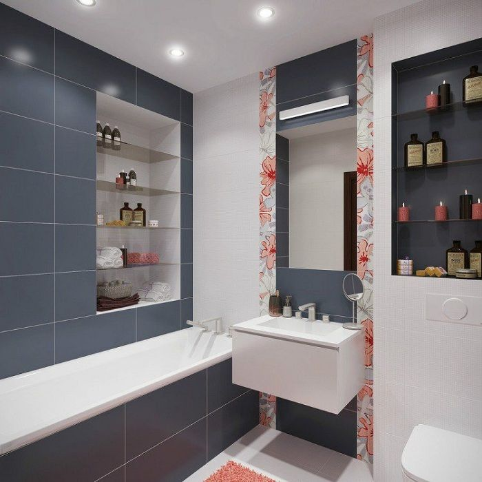 Interior of bath-room transformed by color inserts on the tiles that look wonderful.