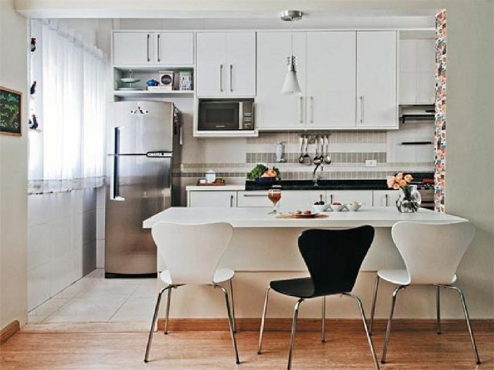 Interior kitchenette transformed through the use of bright colors, plus an additional black interior elements.
