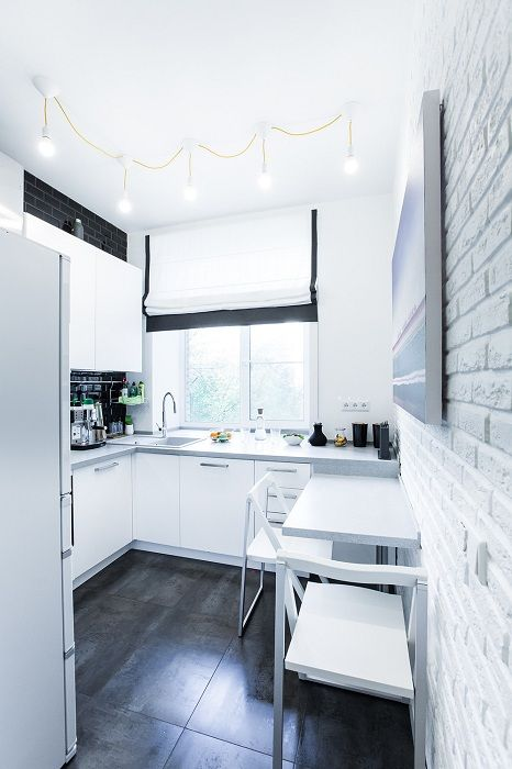 A perfect example of kitchen design in shades of white, which would be a godsend.