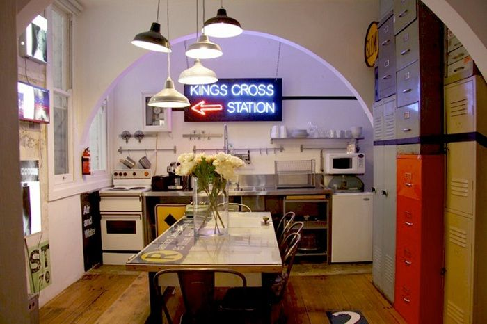 The best solution to create a cool interior with a small kitchen area and the original arch.
