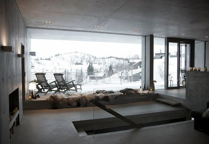 Filter Arkitekter. Large windows offer a great view of the mountain landscape.