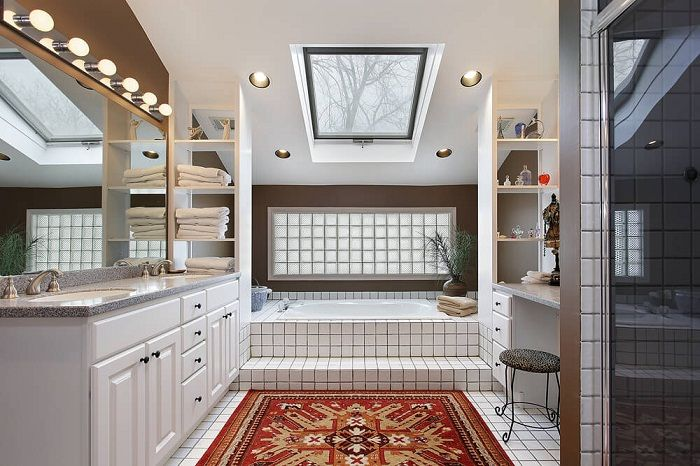 To transform the interior in the bathroom possible through the use of white tiles.