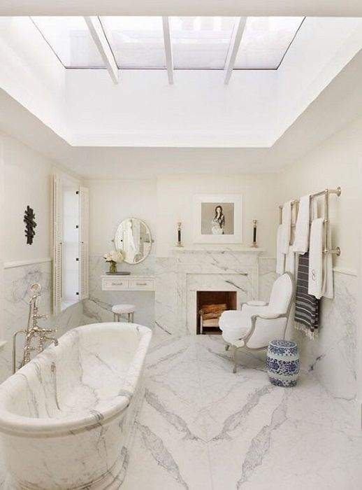 Beautiful and memorable interior in the bathroom is created through its execution in marble textures.