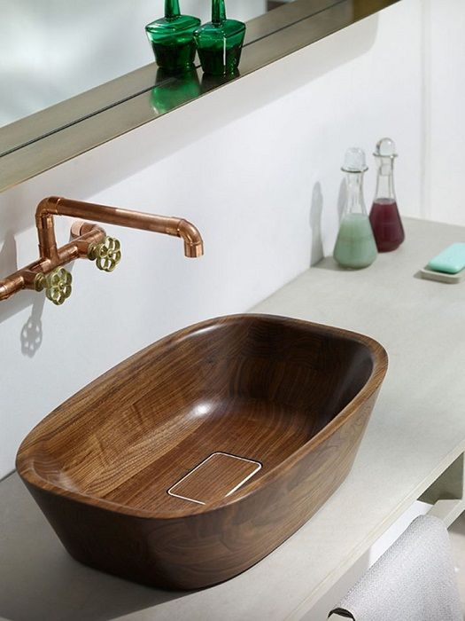 Cool option to refine the interior of a bathroom with a wooden shell.