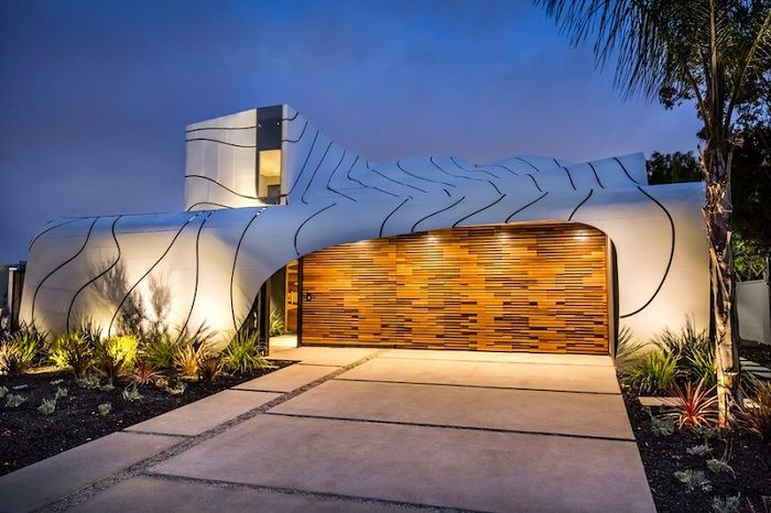 Wave House - a private mansion with a spectacular wave-like facade.