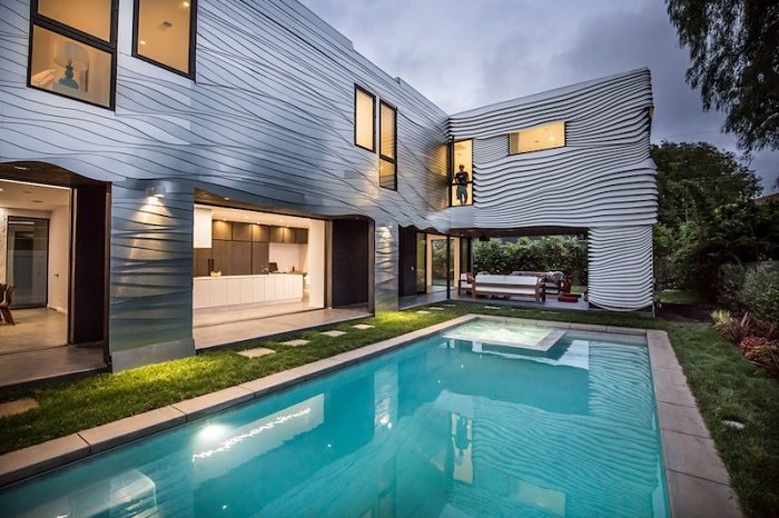 Wave House - house, steering undulating aluminum panels.
