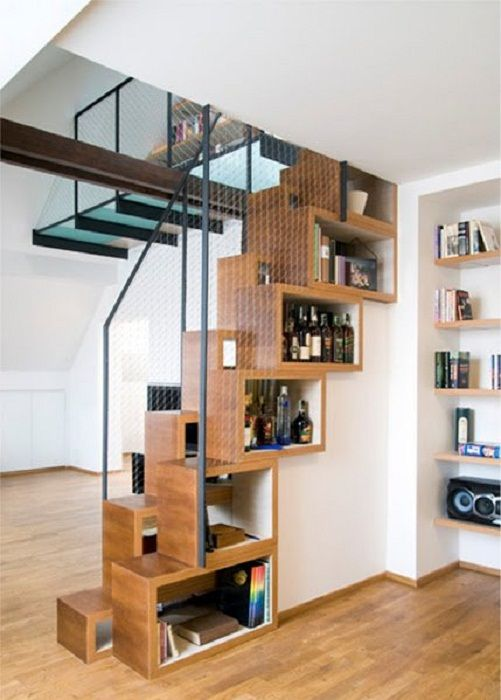 Pretty option to create additional space in the form of shelves under the stairs that just like it.