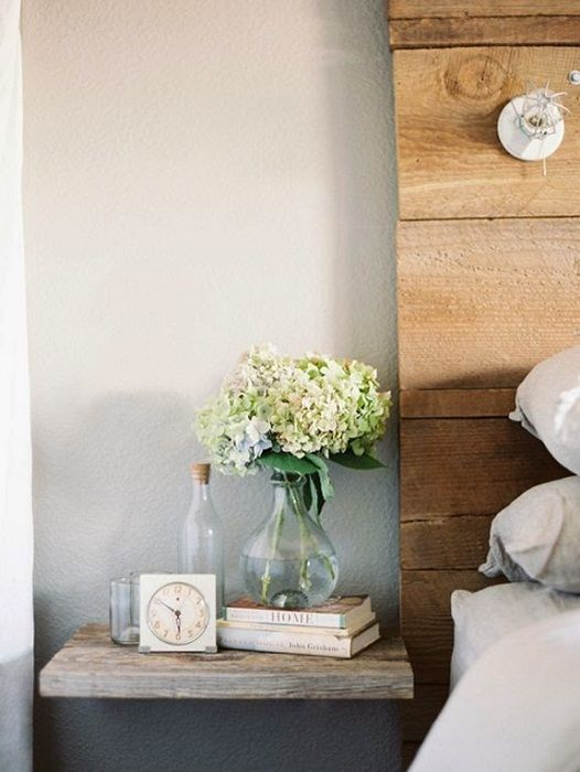 A great option to transform the space into a bedroom using tiny hinged shelves.