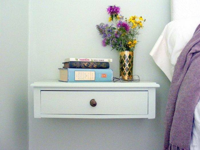 Bedside space is transformed using a shelf with a single compartment.