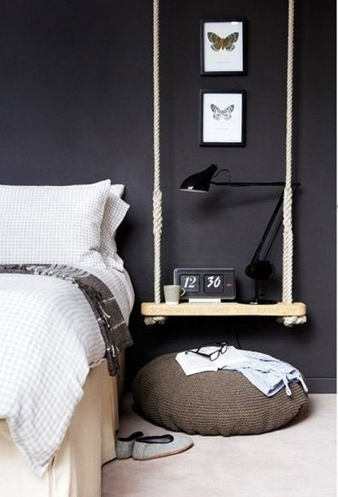 Bedside space beside the bed is decorated in interesting motifs using original hinged shelves.