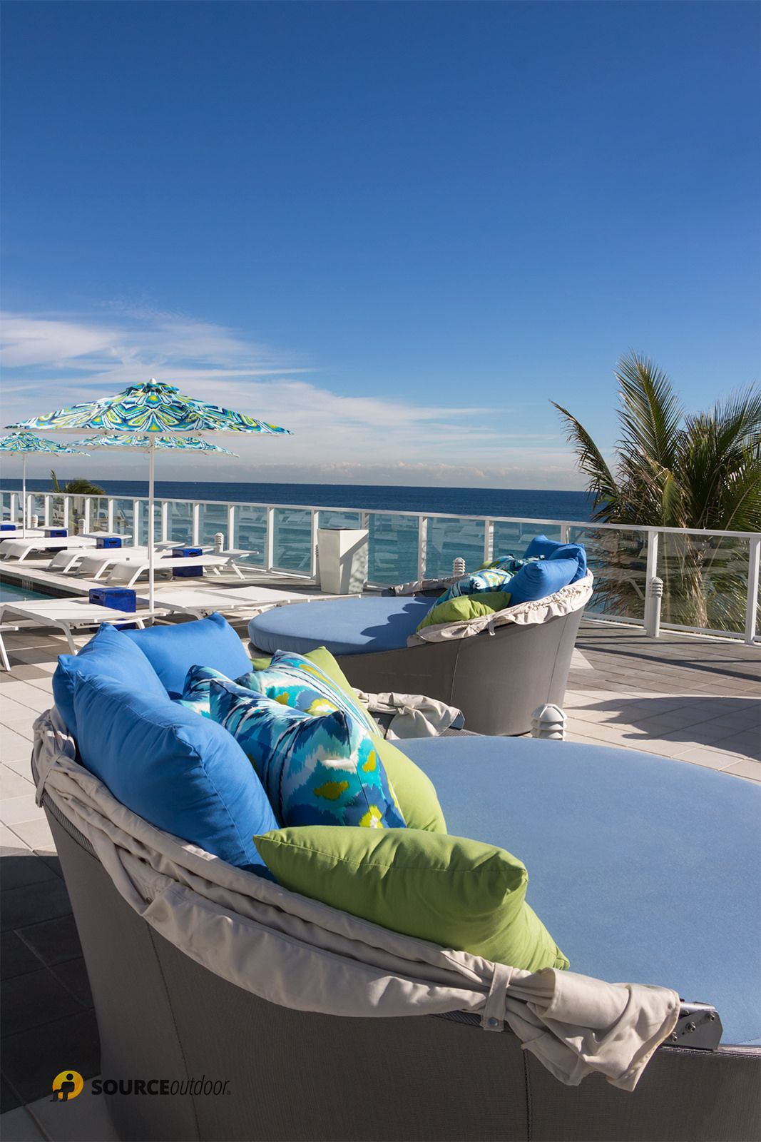 Cool aqua couches with pillows set on the terrace