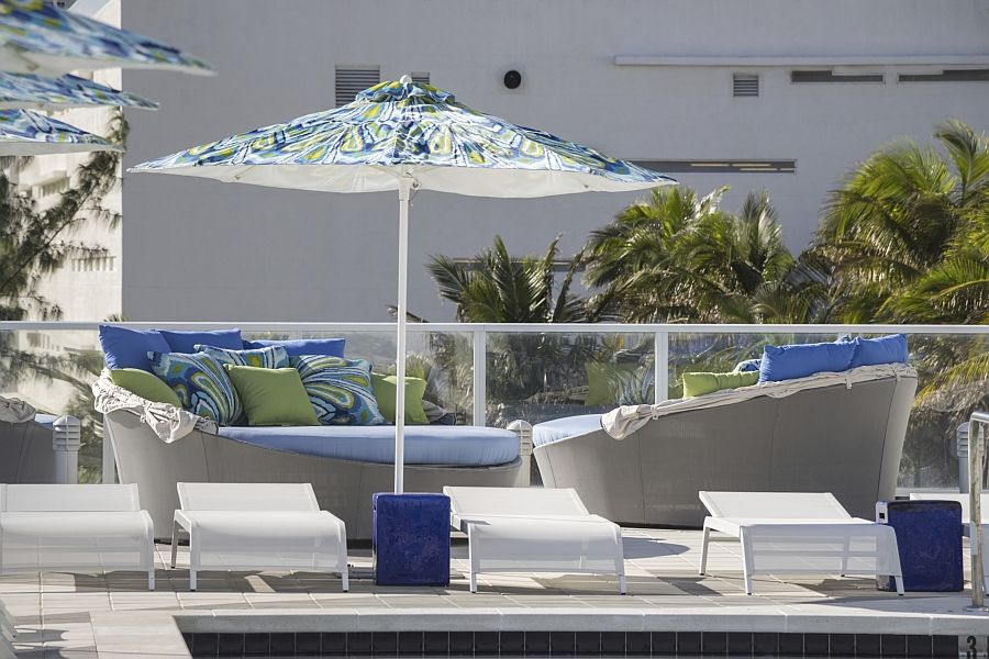 Aqua couch with an umbrella from the sun on the terrace