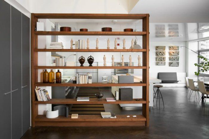 A good option zoned space with the help of a wooden cabinet with shelves.