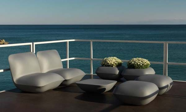 Beautiful armchairs, chairs, desks and tables on the balcony