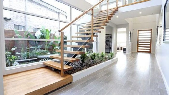 Perhaps one of the best options for decorating the space of the house with a wooden staircase and a mini garden.