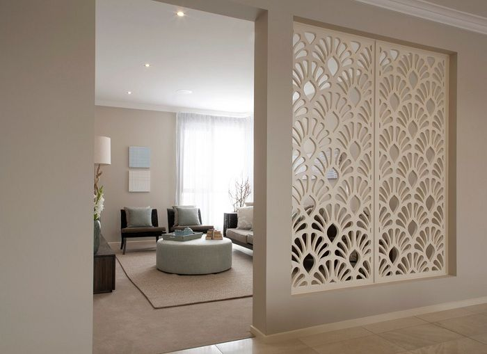 The best solution to decorate the room with the help of the partition, which optimizes the space of the house.