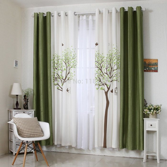 A surprising choice to decorate the interior of the room is dark-green curtains.