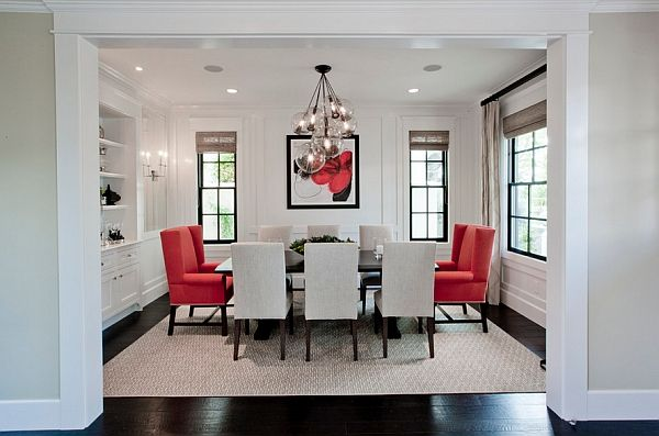 The bright dining room with bright crimson chairs
