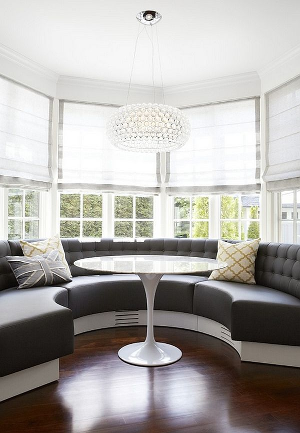 The large semicircular sofa in the bay window