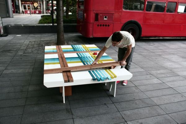 Man collects colorful bench