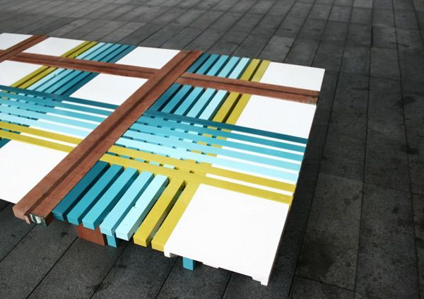 Wonderful bench of blue, green and brown stripes