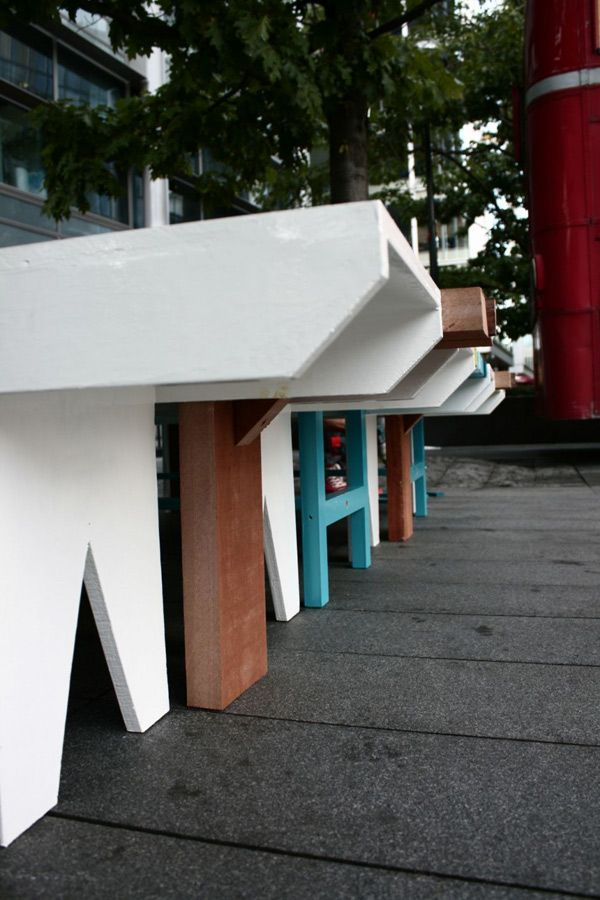 The legs of benches in different colors and shapes