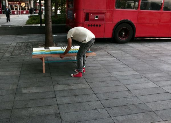 A man collects colorful wonderful bench