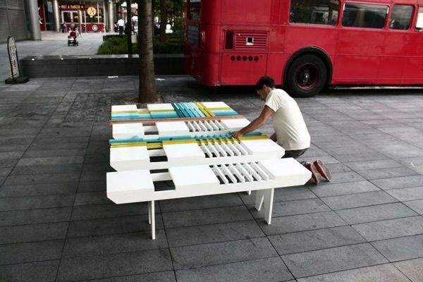A man collects colorful bench