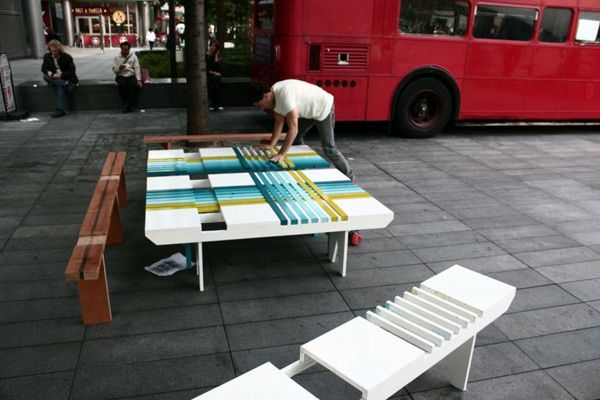 A man collects colorful creative bench