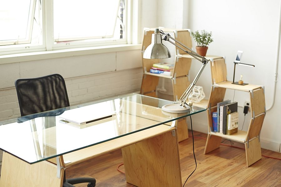 Office desk lamp and modular bookcase by the window