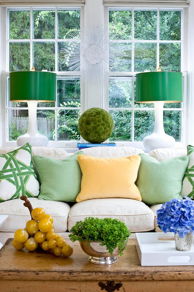Bright table lamps in the living room interior