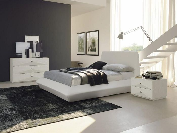 An interesting variant of arrangement of bedrooms in classic black and white.