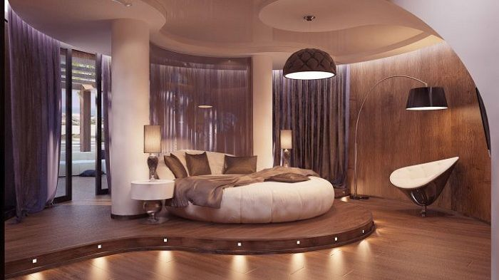 A great example of design of the room for sleeping with soft and gentle shades of coffee and cream.