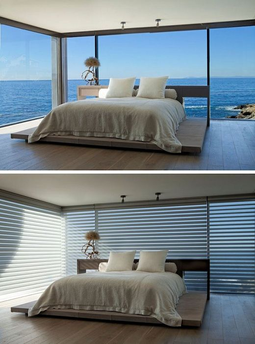 Excellent design bedroom with a bed on a wooden platform and a gorgeous view.