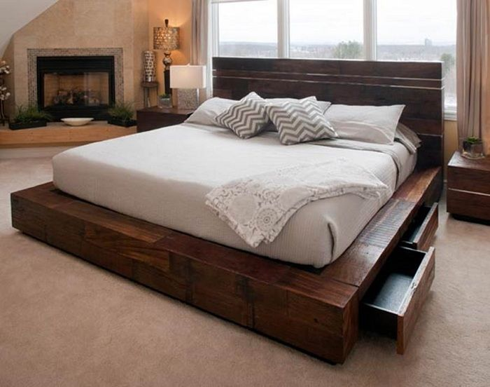 Great design bedrooms with beautiful and practical bed on a wooden platform.
