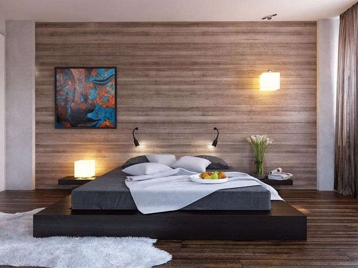 The bedroom, which is decorated in a contemporary style with a cool bed on a platform.