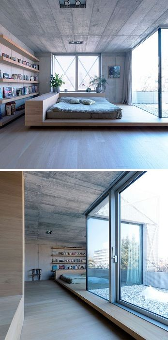 The stunning interior with a cool bed with a gorgeous window on a wooden platform.