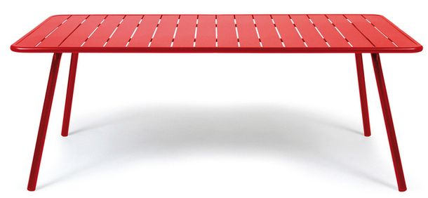 A small bright red metal table