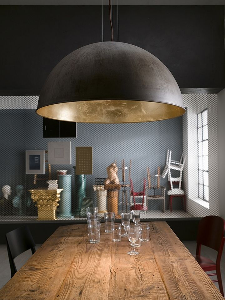 Brass pendant lamp Galileo in the form of a hemisphere in the dining room interior