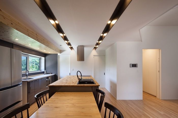 Baomaru House. Kitchen with dining room.