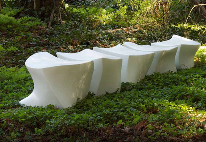 Bench of lightweight concrete on the grass