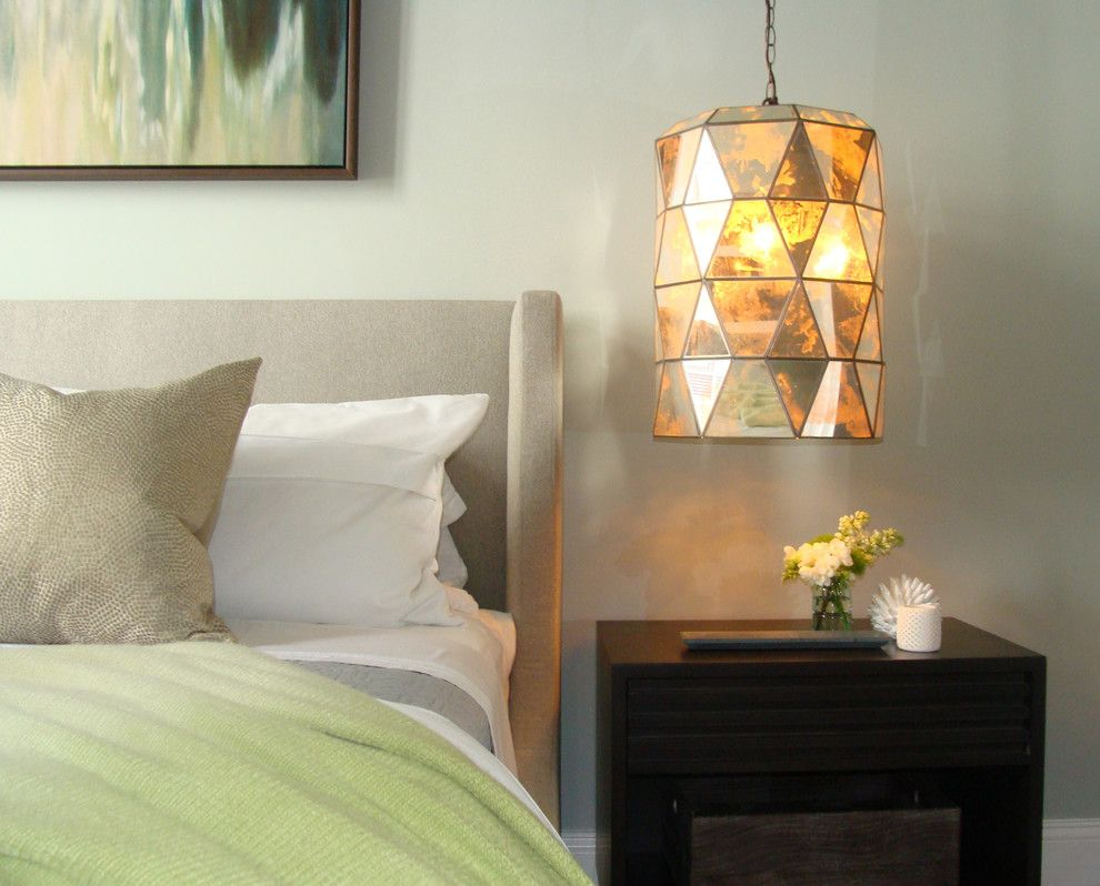 Round pendant lamp in the interior of a bedroom