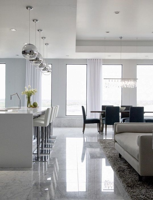 A nice combined living and dining area, which are made in white color that refreshes the interior.