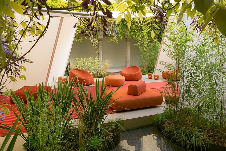 Orange couch, sofa, armchairs and ottomans on the terrace