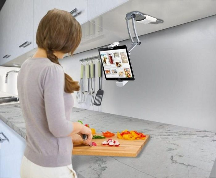 Modern design solution for the decoration of the workplace in the kitchen well-equipped stand for the tablet.