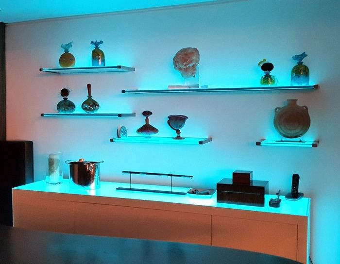 Original and functional glass shelves with lighting.